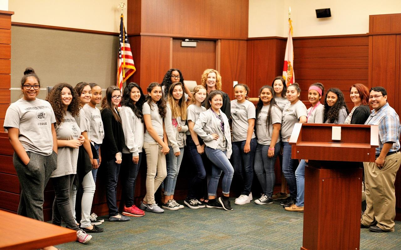 Circuit Judge Diane Tennis with students from Osceola County