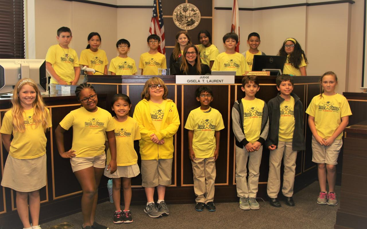 Orange County Judge Gisela Laurent with students from the Star Child Academy